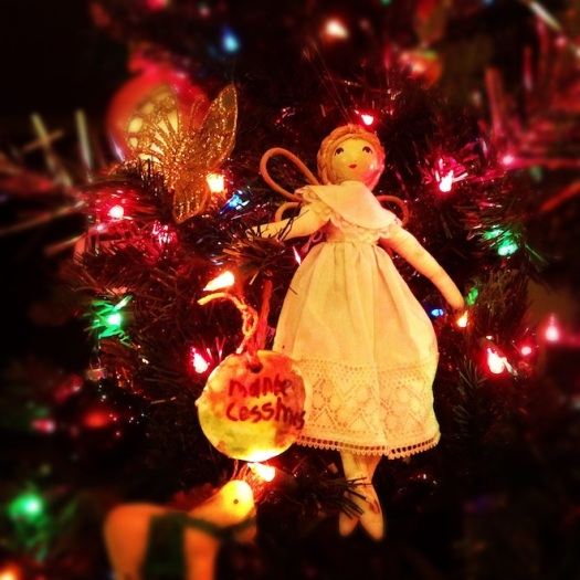 We put up the tree. An angel I love from my childhood, and one of my son's handmade ornaments. Image by Natania Barron, CC BY SA 3.0